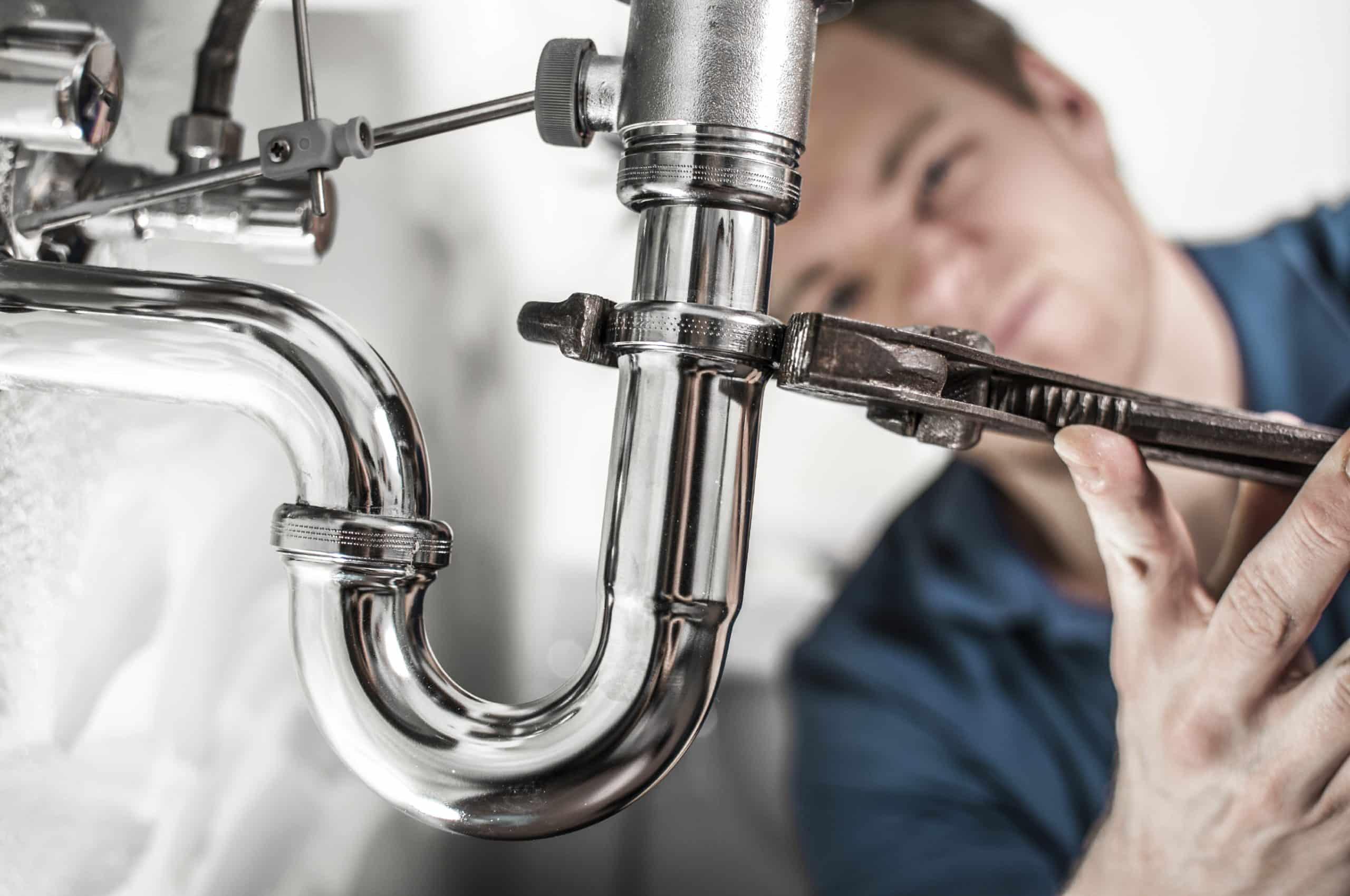 Plumbing Contractor Repairing Sink